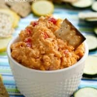 This DRUNKEN PIMENTO CHEESE is a twist on the classic spread that you'll want to eat with everything!