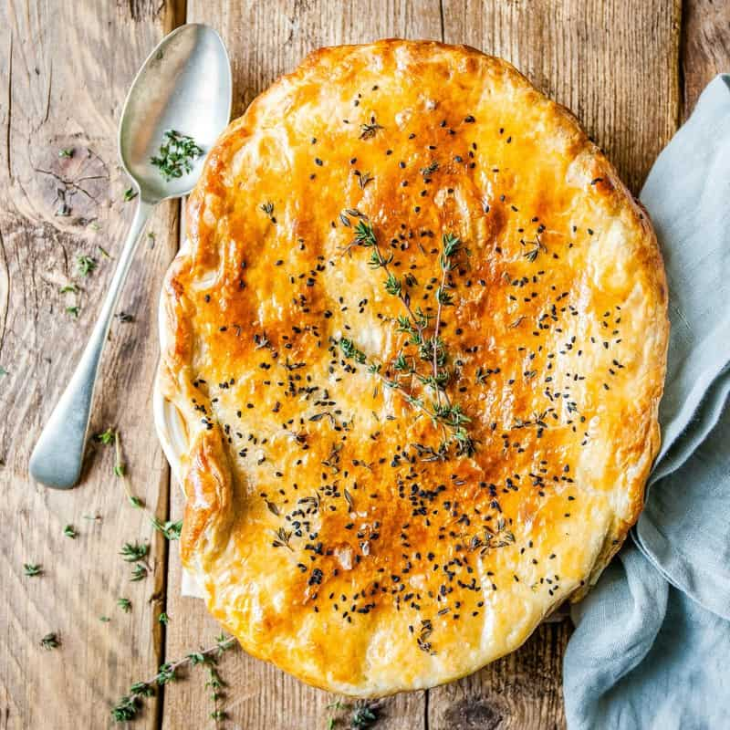 The BEST Easy Chicken Pot Pie in the world. It has a creamy filling, tender chicken, herbs and vegetables and it's all baked under a golden puff pastry lid!