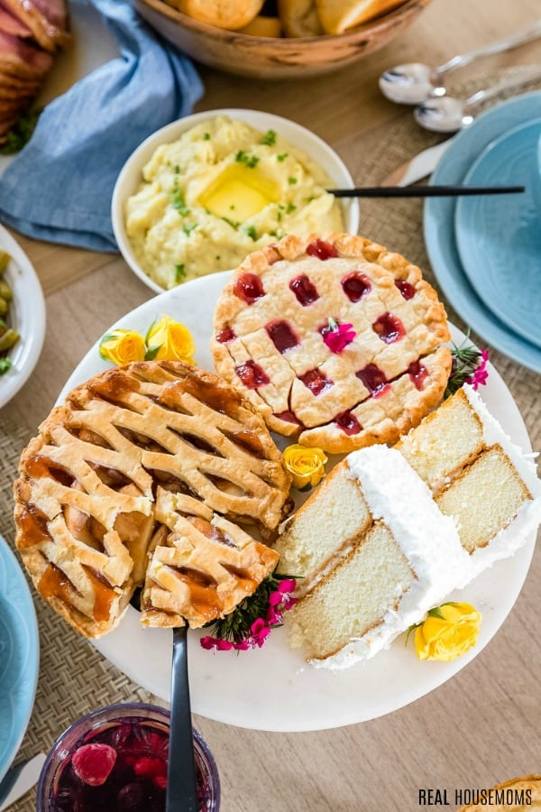 dessert plate with small pies and cake slices