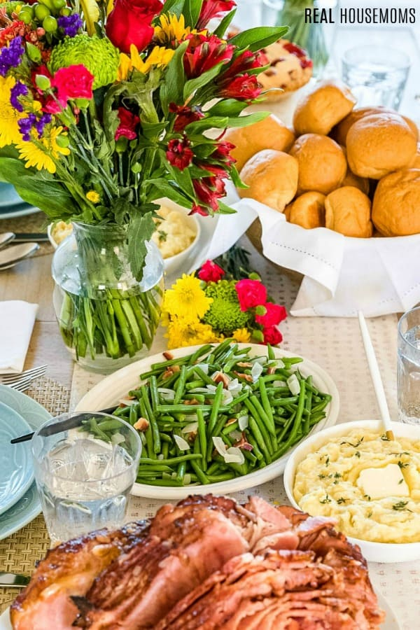 close up of Easter dinner table loaded with food and flowers