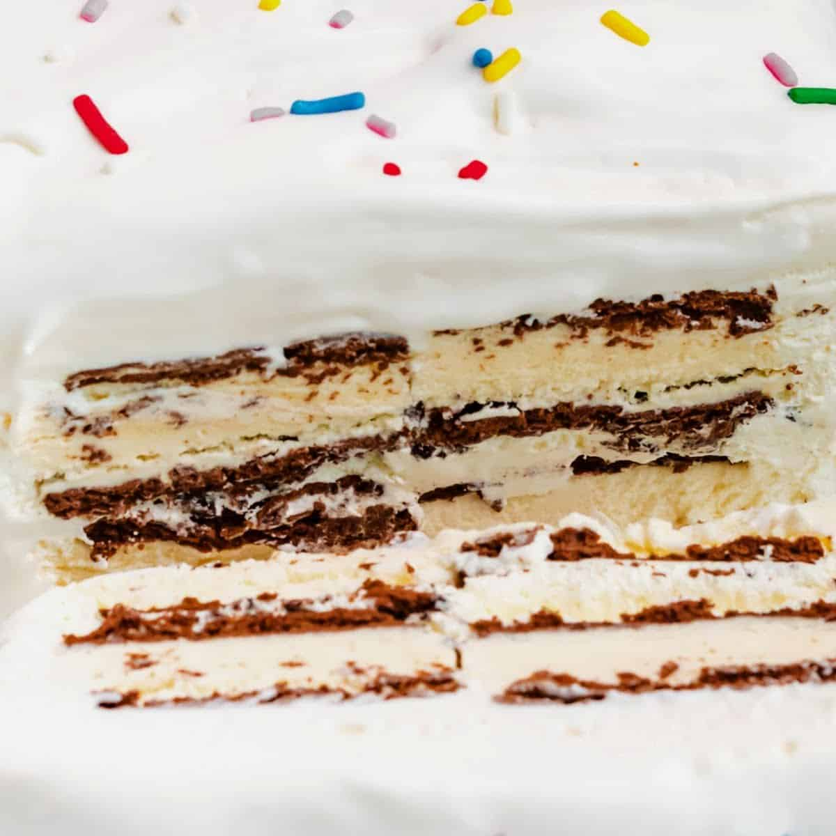 square image of ice cream sandwich cake with a slice cut off to show layers
