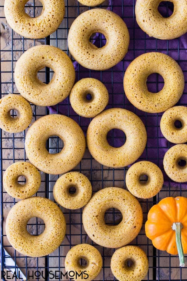 Baked Pumpkin Spice Donuts on a cooling rack ready to be glazed