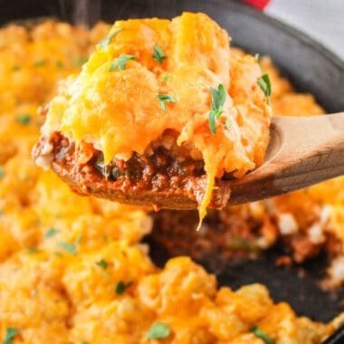 square image of a spoonful of sloppy joe casserole over a skillet