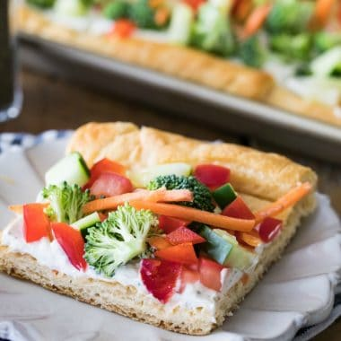 Have you ever tried Easy Veggie Pizza before? With a buttery, crescent-roll dough base and lots of crisp, fresh veggies, this recipe is always a crowd pleaser!