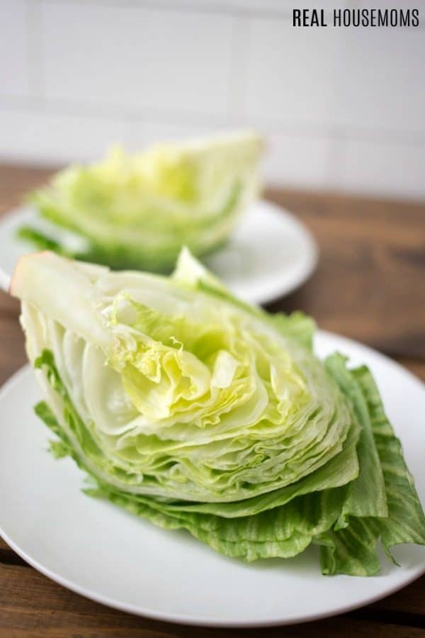 iceberg lettuce cut into quarters for wedge salad