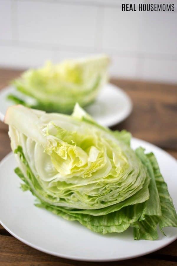 iceberg lettuce cut into quarters for wedge salad