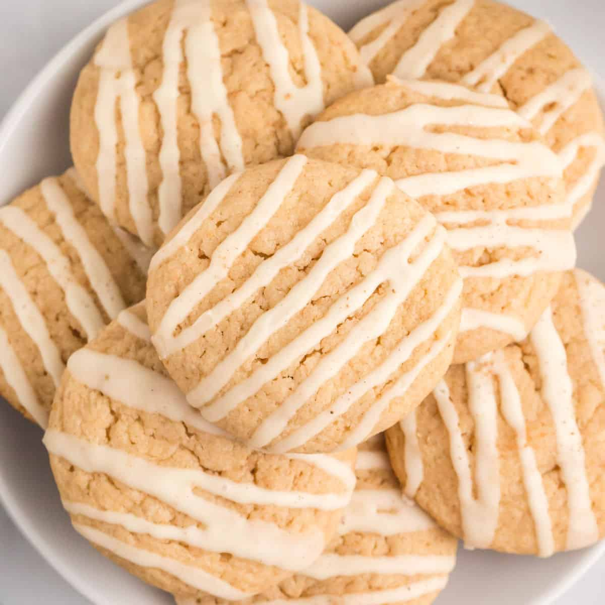 square close up image of eggnog cookies piled on a plate