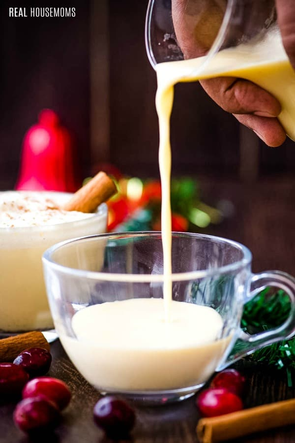 eggnog being poured into a mug