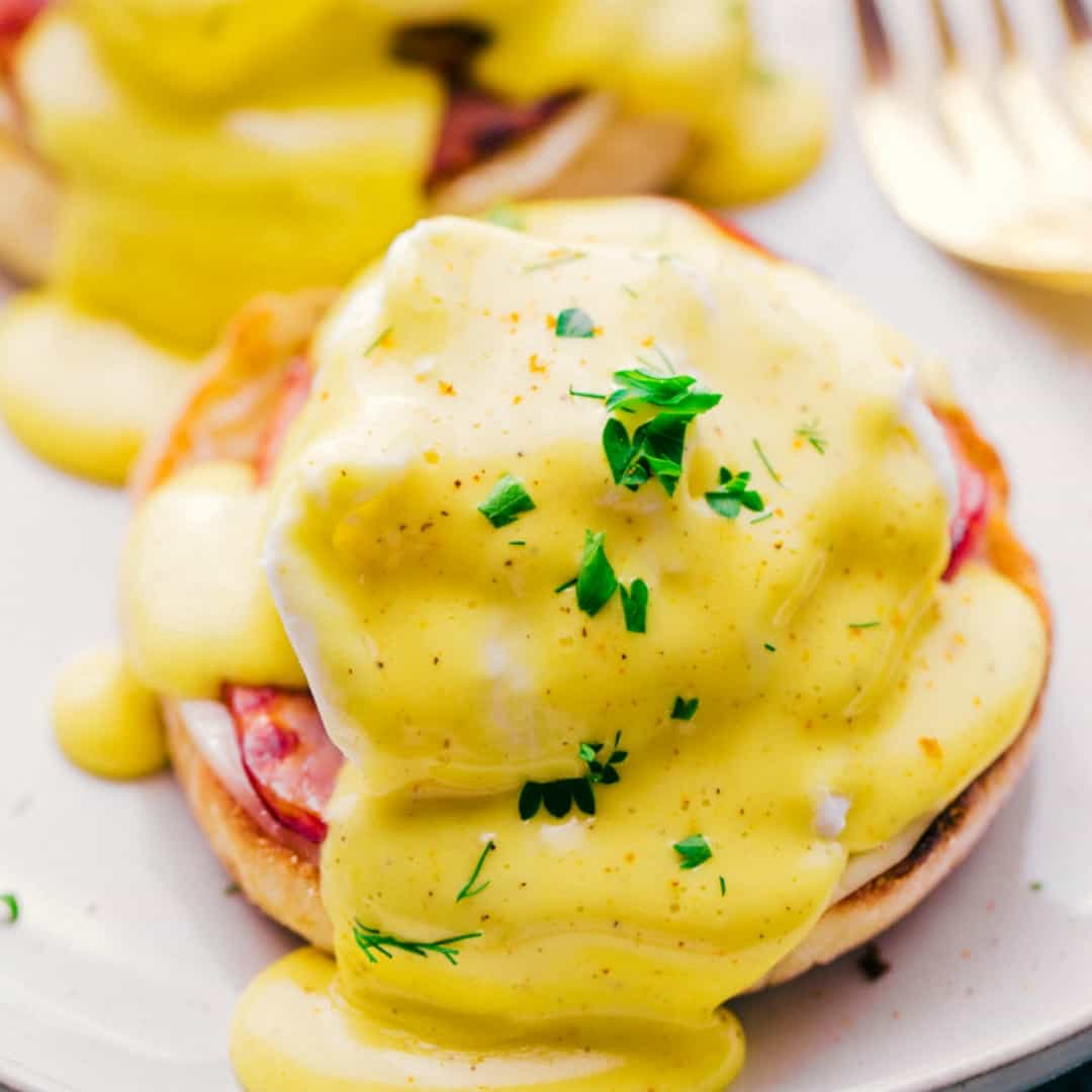 Eggs Benedict with Hollandaise Sauce is layer upon layer creamy, rich decadence with a perfect poached egg. One bite says it all!