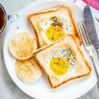 Call it Eggs in a Basket or Egg in a Hole. It doesn't matter what you call this easy and simple breakfast you just can never go wrong making it!