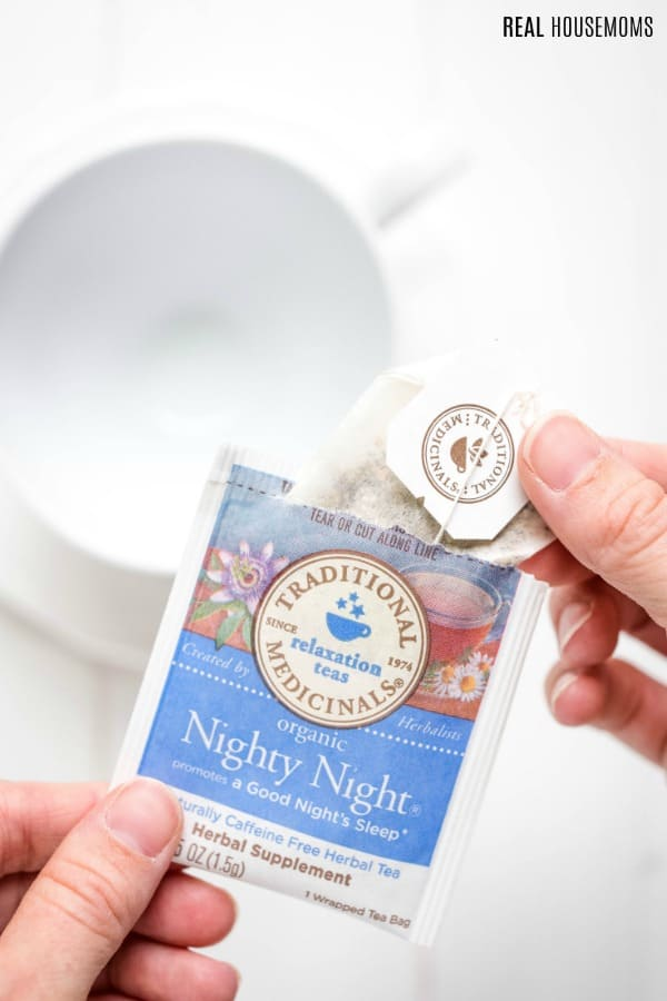 packet of Traditional Medicinals Nighty Night tea with an empty mug
