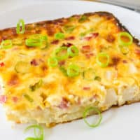 Farmer's Casserole is a delicious way to start your day! Hash browns, ham, cheese & eggs create a delicious breakfast casserole that's perfect for brunch!