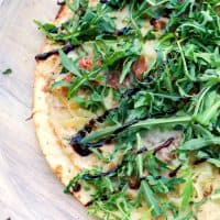 Lighten up dinner with this easy, gourmet Fig & Prosciutto Pizza! Ready in about 20 minutes on the grill or in the oven, it's perfect for summer!