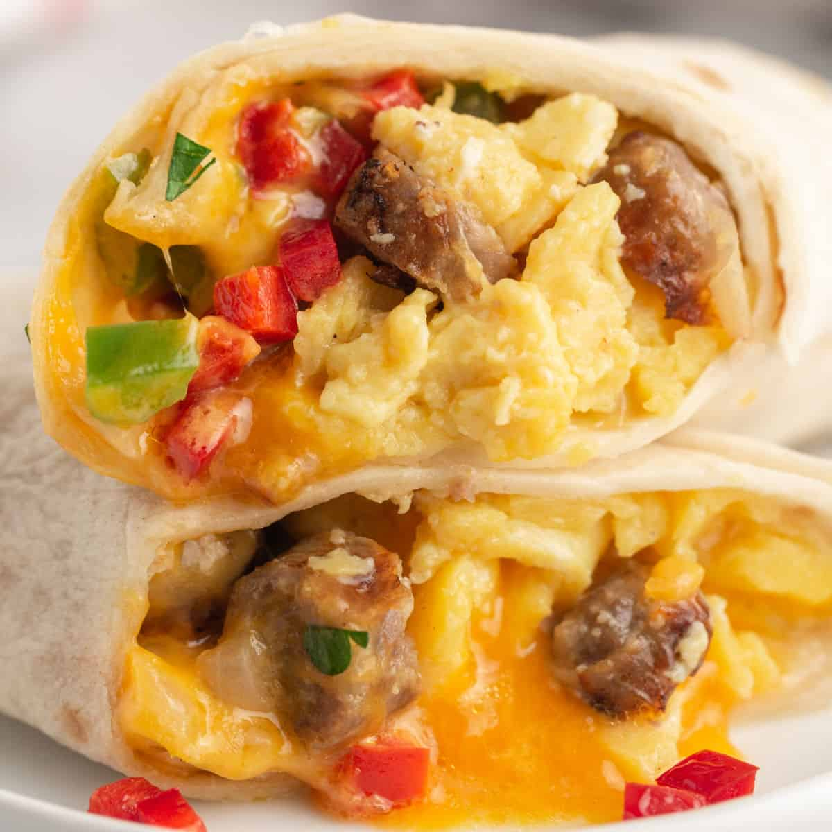 square image of two freezer breakfast burrito halves stacked on top of each other