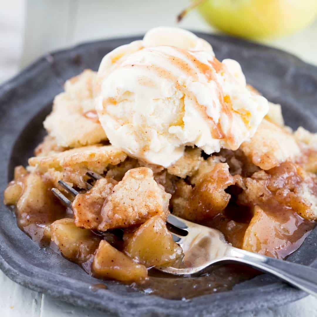 This French Apple Cobbler is delicious and comes together so fast! The baked apples are great with the vanilla baked topping and work perfectly with vanilla ice cream on top!