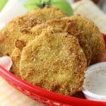 """FRIED GREEN TOMATOES are a great way to use up the unripe tomatoes from your garden. Crispy, tart and oh-so-Southern they'll have you grabbing a glass of sweet tea and saying """"ya'll"""" in no time!"""