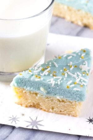 Frosted sugar cookies bars that are soft, chewy & topped with buttercream