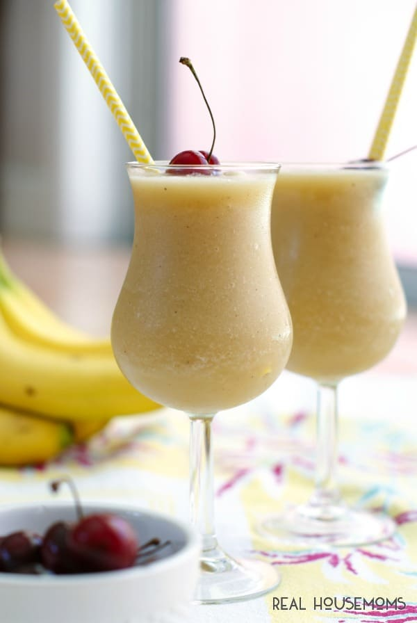 This FROZEN BANANA DAIQUIRI is made with two kinds of rum and frozen bananas for a taste of the tropics that is perfect for summertime sipping!