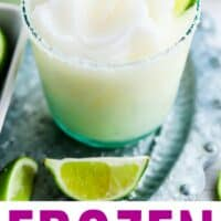 frozen margarita in a rocks glass with salt and lime