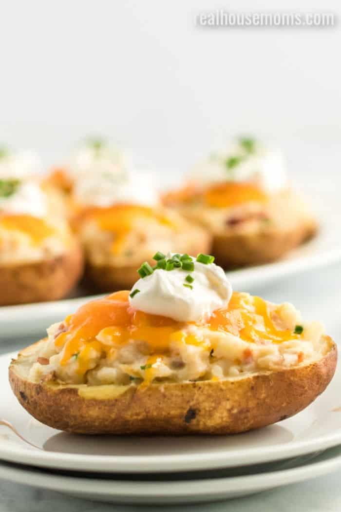 loaded twice baked potato on a plate