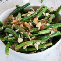 Need a healthy side dish with tons of flavor? This Garlic, Lime & Almond Green Bean recipe is it! Bright lime and garlic are the perfect way to dress up these beans!