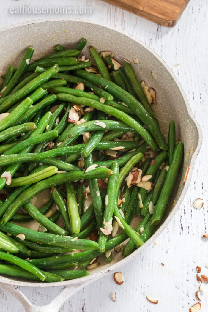 close up of green beans in a skillet