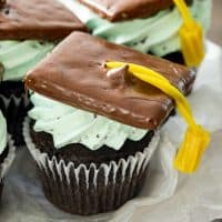 "Chocolate cupcakes, whipped mint chocolate chip cream cheese frosting, and a graduation cap and tassel! These Graduation Cupcakes or should we say ""cap""-cakes are perfect for impending Graduation parties!"