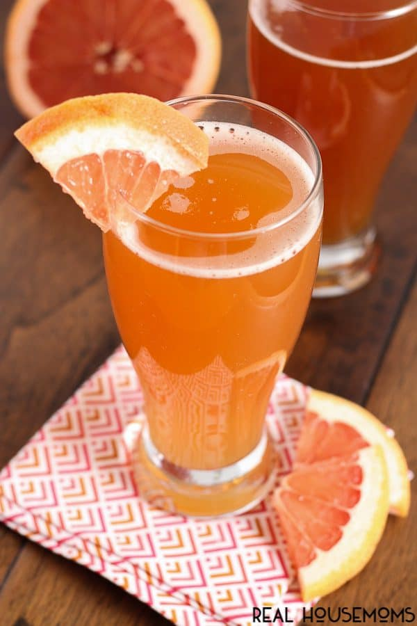 This light and refreshing GRAPEFRUIT SHANDY is bursting with sweet grapefruit flavor. It's topped with ice cold beer, making it a shandy that's perfect for summer sipping!