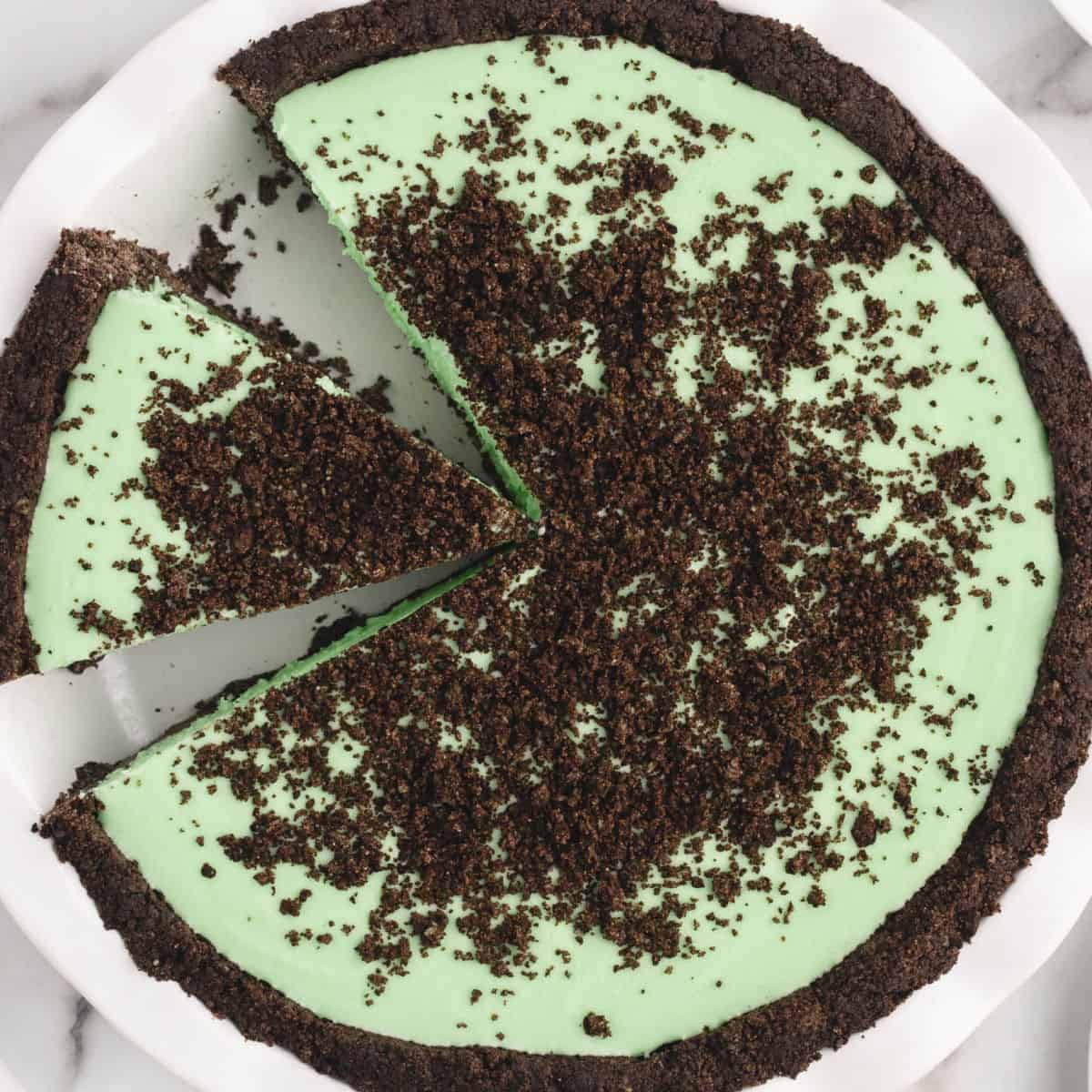 square image of a grasshopper pie with a slice cut out