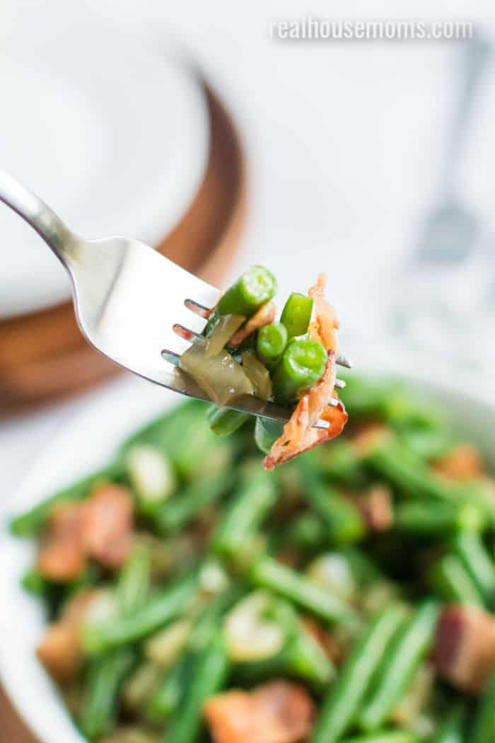 fork with green beans and bacon