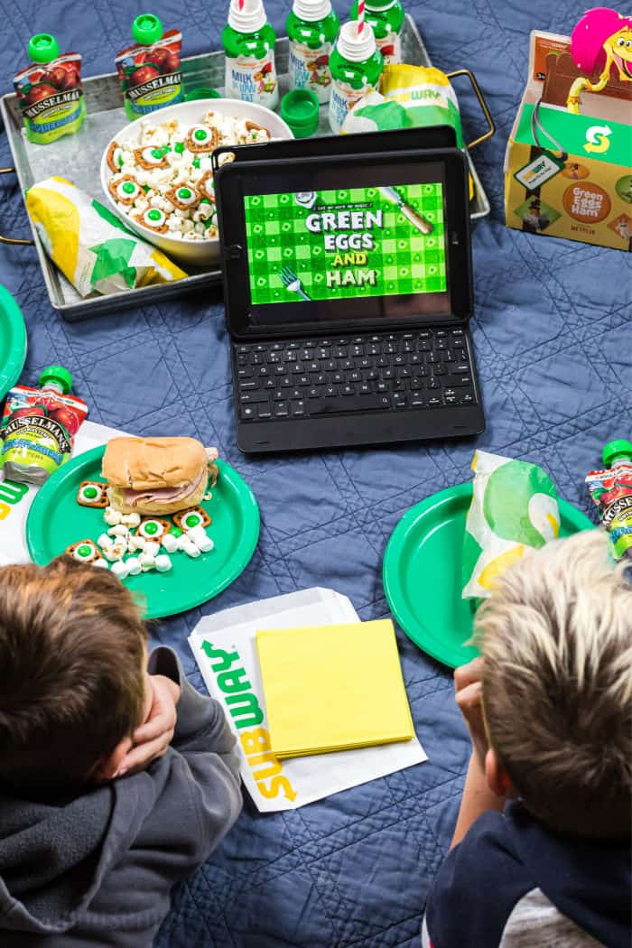 kids having an indoor picnic watching green eggs & ham on netflix