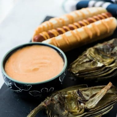 Grilled Artichokes with Honey Sriracha Dipping Sauce make summer grilling super easy and tasty! I love to serve them up with a simple dish like grilled hot dogs.