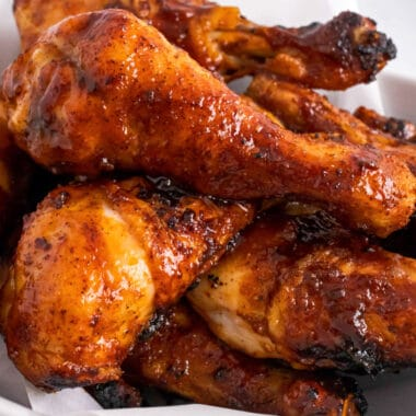 square image of bbq chicken legs piled up