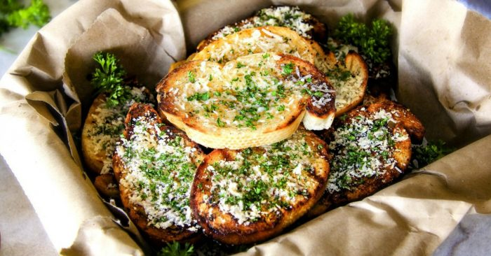 Finished Grilled Parmesan Garlic Bread in a brown paper lined basket