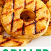 grilled pineapple rings on a platter with recipe name at bottom