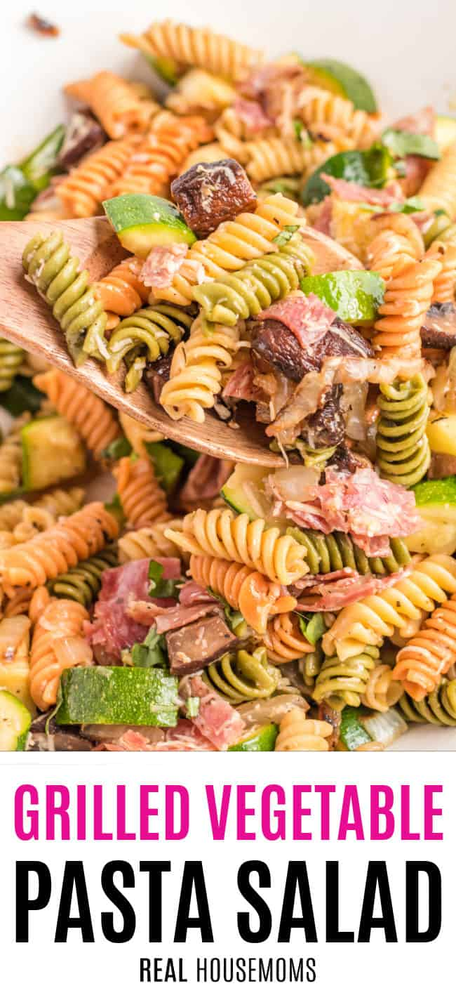serving spoon of grilled vegetable pasta salad over the bowl