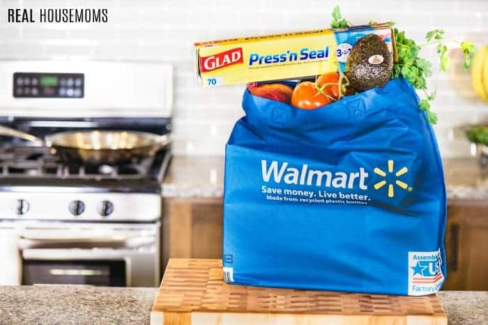a bag of groceries, glad press 'n seal, and taco ingredients from Walmart