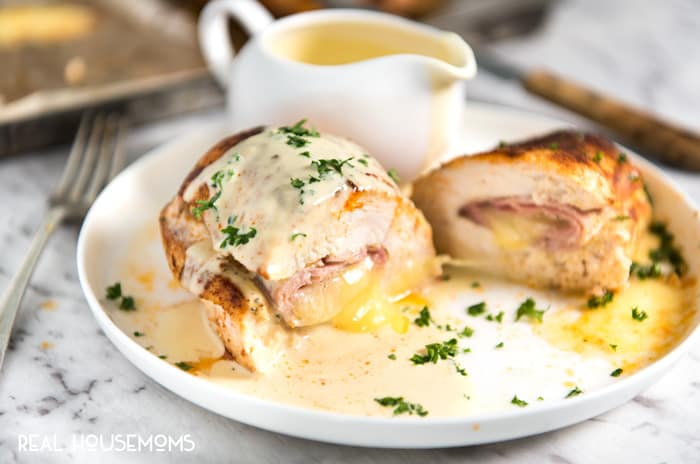 This EASY Baked Ham & Cheese Stuffed Chicken with a wickedly delicious Mustard Cream Sauce tastes like Cordon Bleu, minus the crunchy coating, but is about 5x faster to make!