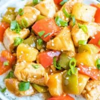 Hawaiian Chicken Bites are an easy dinner or appetizer recipe made with chicken, bell peppers, and pineapple tossed in a sweet, tangy sauce!