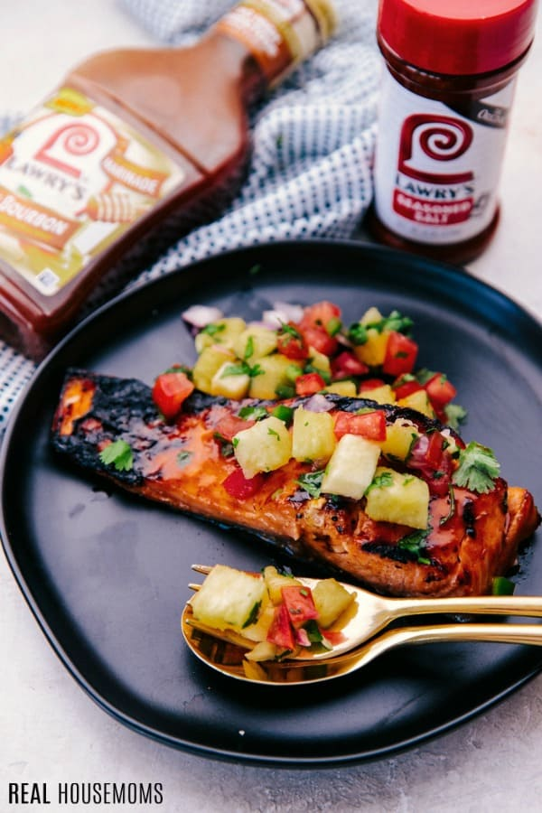Hawaiian Grilled Salmon Filet on a dinner plate with pineapple salsa