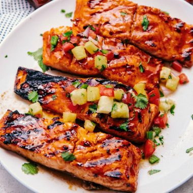 Hawaiian Grilled Salmon Filets have layers of delicious honey bourbon flavor, are grilled with apple-infused wood chips & topped off with fresh pineapple salsa!