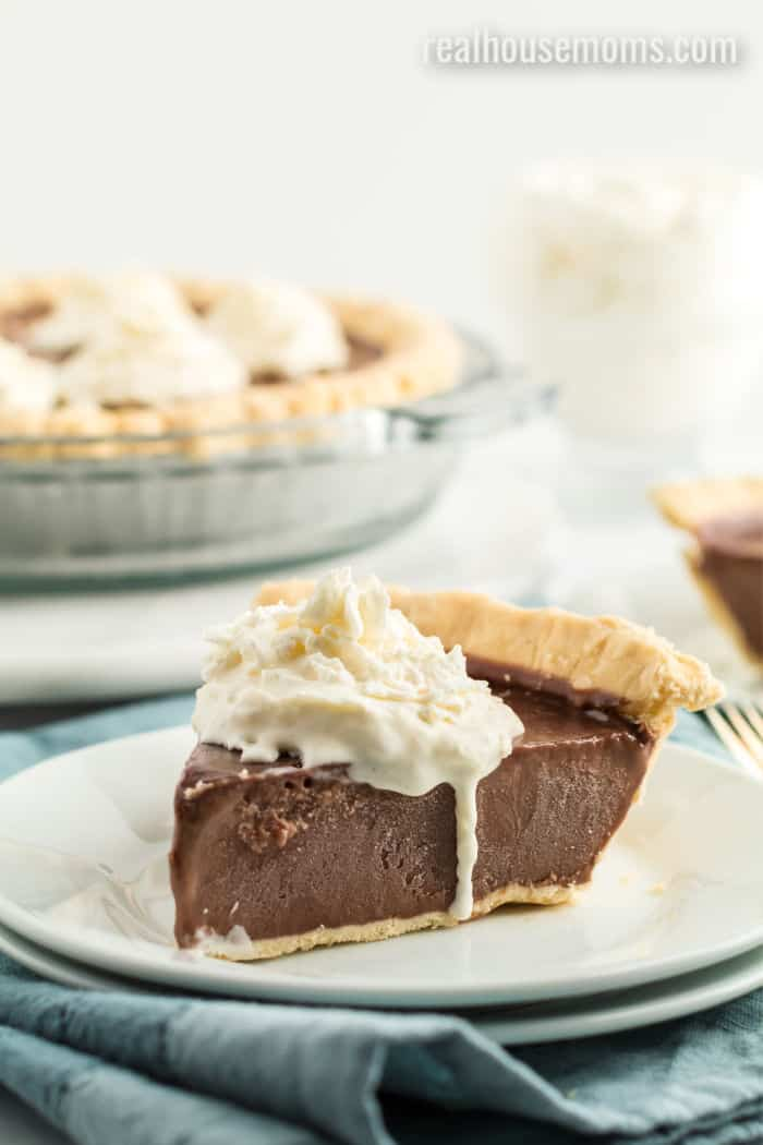 slice of chocolate cream pie topped with whipped cream