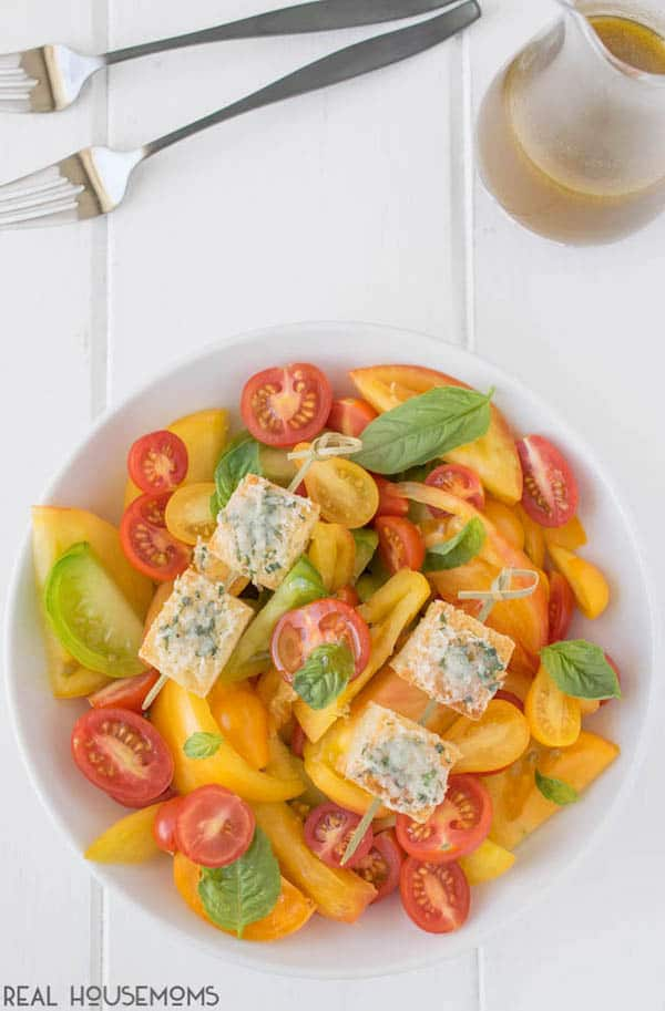 HEIRLOOM TOMATO SALAD is an easy and very colorful side dish served with fresh basil and crispy, cheesy croutons for a fresh summer bite you'll love!