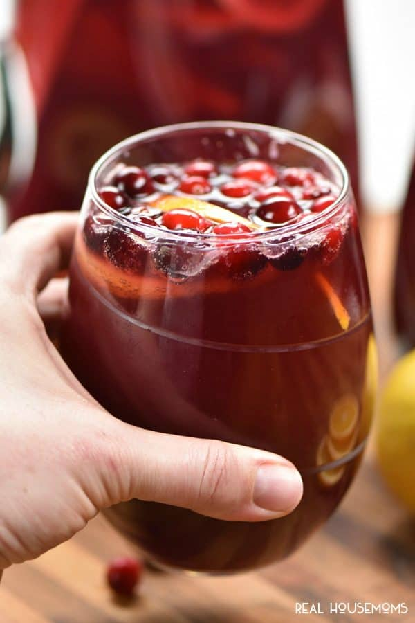 Holiday Sangria is a sweet wine cocktail loaded with fruit and juices that's a perfect drink for the holidays! Make it ahead of time to serve later!