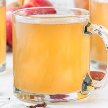 square image of homemade apple cider in a glass mug