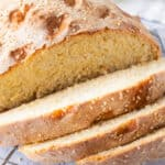 square image of a loaf of cheese bread with slices cut off to show crumb