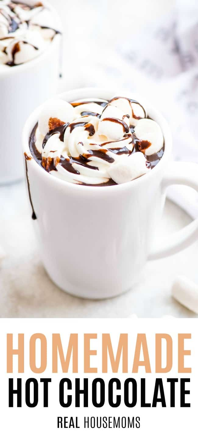 mug of homemade hot chocolate with whipped cream and marshmallows