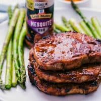Honey BBQ Pork Chops seasoned with McCormick's Mesquite Dry Rub and topped with homemade honey barbecue sauce is the best recipe for juicy pork chops on the grill this summer!