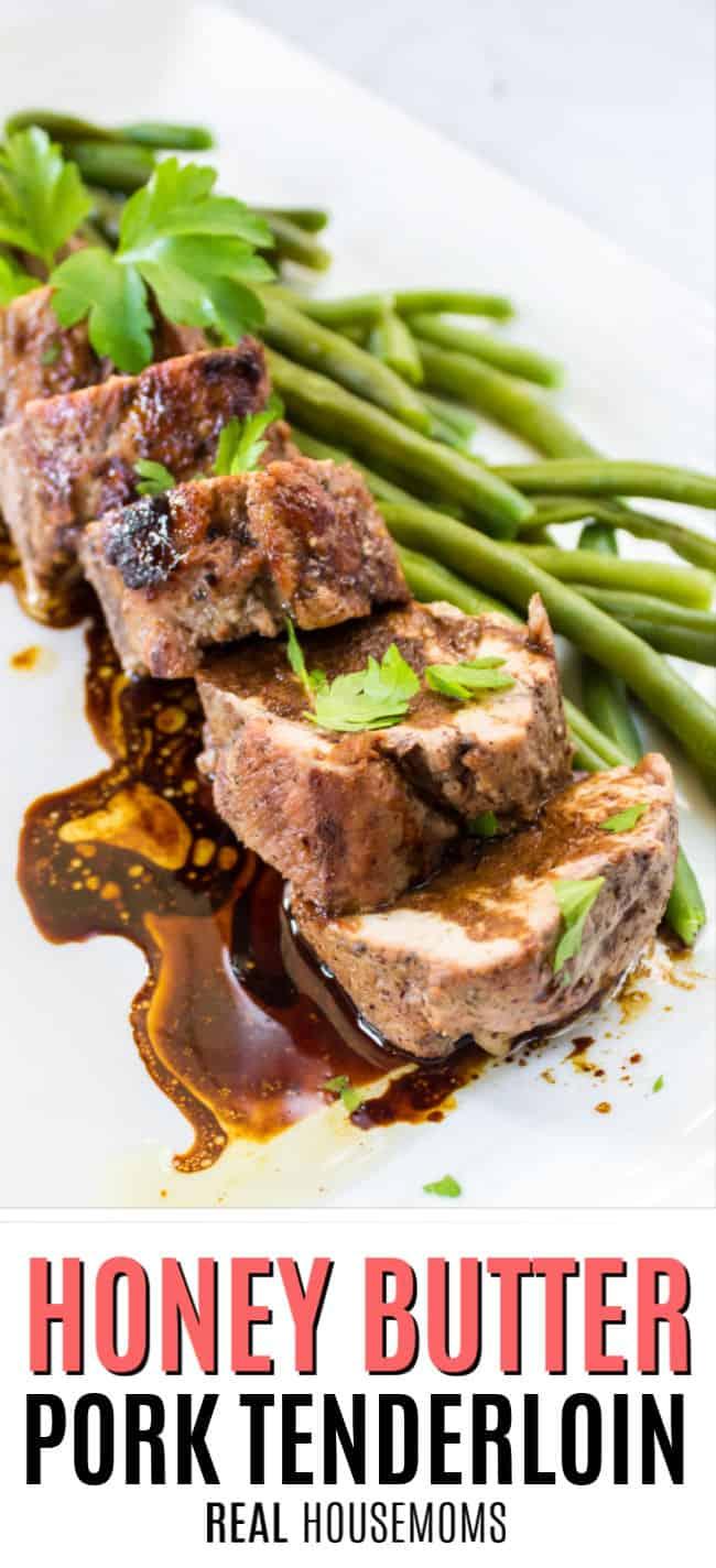 sliced pork tenderloin with honey butter sauce on a serving platter with green beans