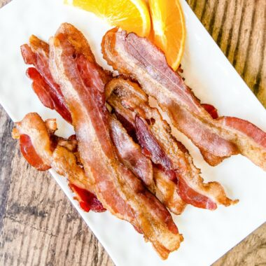 Learn the best, easy way to cook bacon in the oven perfect every time using the top hacks and tricks out there, including how long to cook oven bacon!